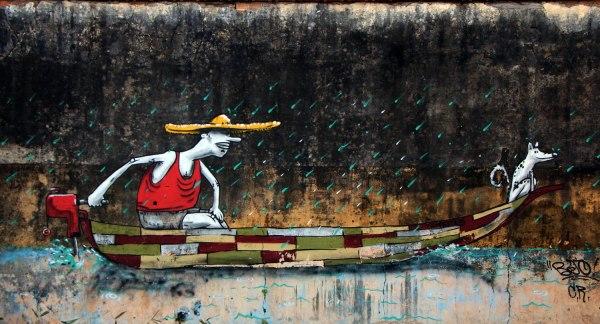 Muro grafitado , em Cananéia/SP